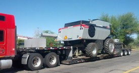 four wheel equipment vehicle on tow trailer