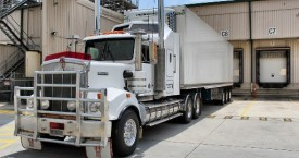 white refrigerated truck at loading dock